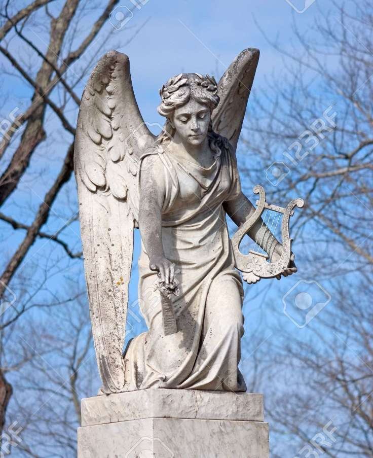9615874-an-aged-statue-of-an-angel-holding-a-harp-stock-photo-wings