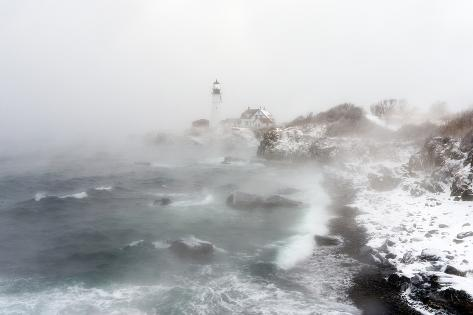 robbie-george-sea-smoke-rises-up-around-maine-s-portland-head-light-on-a-cold-winter-s-day